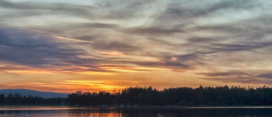 Kayakers enjoying a sunset on Dragon Lake