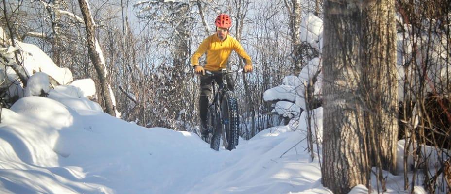 man snow biking